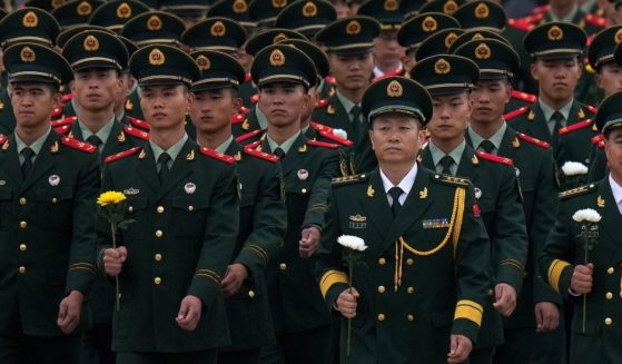 Chinese military officers and paramilitary policemen attend a ceremony for Martyr's Day at Tiananmen Square in Beijing, China on Sept. 30.