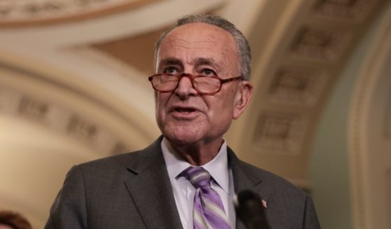 Senate Majority Leader Chuck Schumer addresses reporters following a weekly Democratic policy luncheon on Oct. 5, 2021, in Washington, D.C.