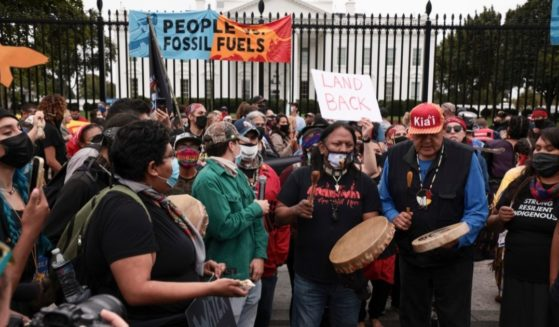 """Left-wing agitators participate in a """"climate march"""" outside the White House on Monday in Washington, D.C."""