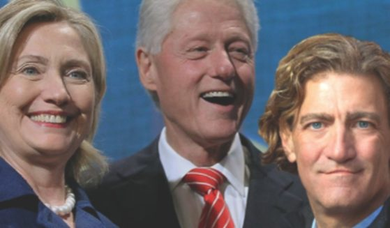 Hillary and Bill Clinton, left and middle, pictured with investor Steve Bachar, right.