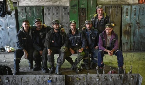 Miners pose for a photo in the locker room prior to entering the shift at Lonea coal mine in Petrila, Romania, one of the coal mining cities located in the mountain area of Valea Jiului on Nov. 24, 2020.