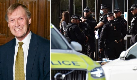 U.K. Conservative MP David Amess, left, is seen at the House of Commons on Oct. 16, 2016, in London. Police officers are seen following the stabbing of Amess as he met with constituents on Friday in Leigh-on-Sea, England.
