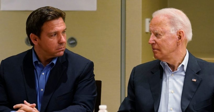 Florida Gov. Ron DeSantis, left, and President Joe Biden stare at each other during a briefing on the condo collapse in Surfside, Florida, on July 1.