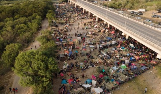 Thousands of migrants camped out under the Del Rio International Bridge in Del Rio, Texas, on Sept. 21.