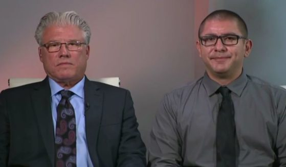 """Denver police officer Jose Manriquez, right, and his attorney Randy Corporon join """"Fox & Friends"""" after Manriquez allegedly lost the ability to walk after he received the COVID vaccine."""