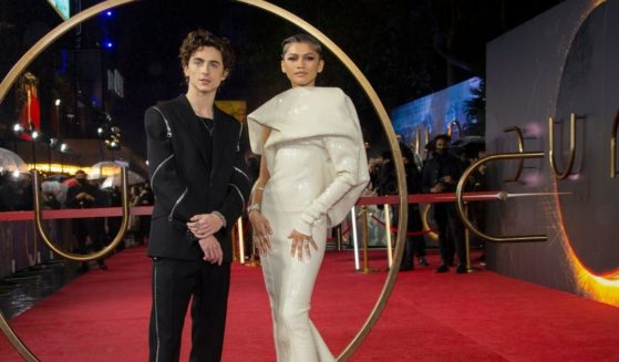 Zendaya, right, and Timothee Chalamet pose for photographers upon arrival at the premiere of the film 'Dune' on Oct. 18 in London.