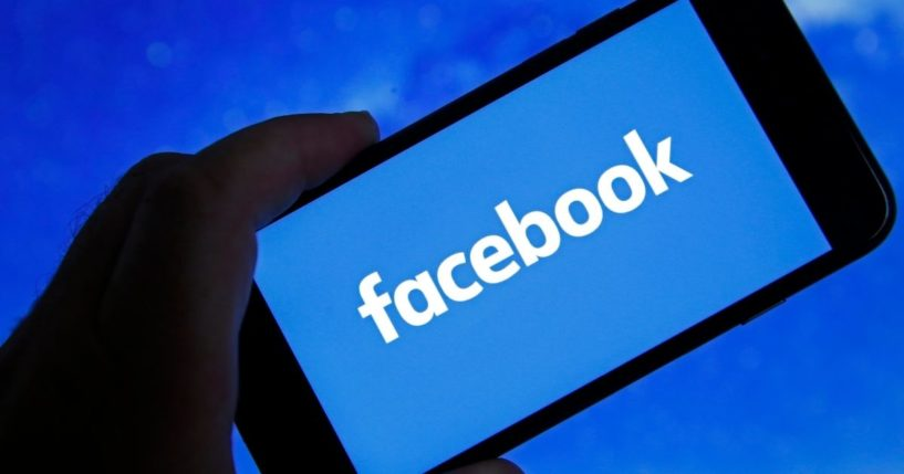 In this photo illustration, the Facebook logo is displayed on the screen of an iPhone on Oct. 6 in Paris.