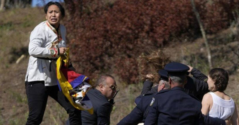 On Monday, Free Tibet activists were escorted away from the Olympic torch lighting ceremony for peacefully protesting China's hosting of the Winter Olympics.