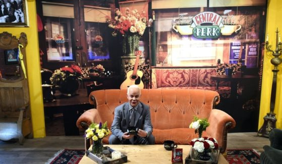"""Actor James Michael Tyler, known for his role as Gunther from the television show """"Friends"""" sits on a couch inside a temporary """"pop up"""" reproduction of the """"Central Perk"""" coffee shop a center piece set of the television situation comedy in New York September 15, 2014."""