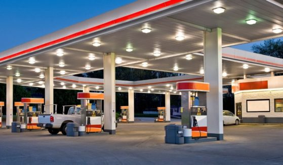 A gas station is seen at night in the stock image above.