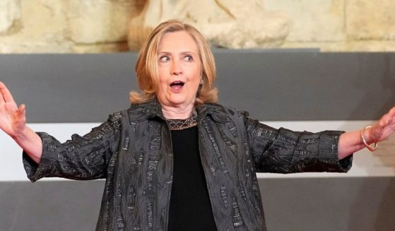 Hillary Clinton attends an international conference to discuss gender equality and allocate funding to women's programs in Paris, France, on June 30.