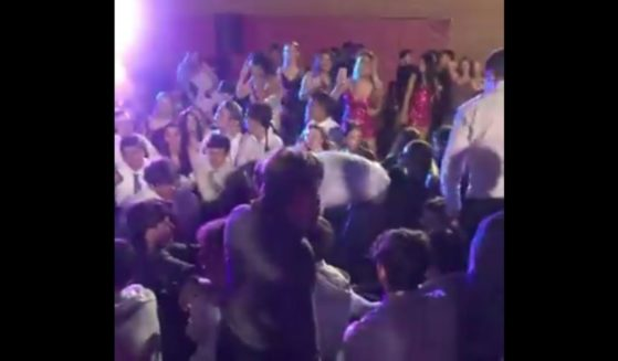 Students at Marist High School in Chicago attend their homecoming dance on Oct. 6.
