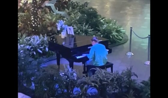 Shawn Foley, a health care worker in Fort Myers, Florida, plays the piano in the lobby of HealthPark Medical Center.