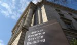 The Internal Revenue Service building in Washington, D.C., is seen in this file photo from March 2013. The proposed new federal budget has provisions granting the IRS additional scrutiny over Americans' bank accounts.