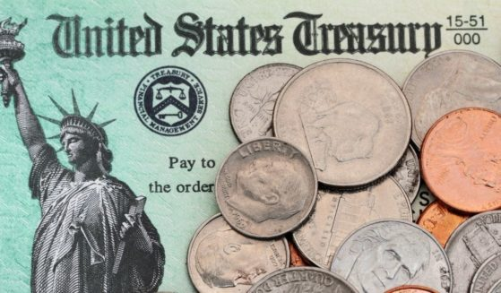 A Treasury Department note with coins is pictured in the stock image above.