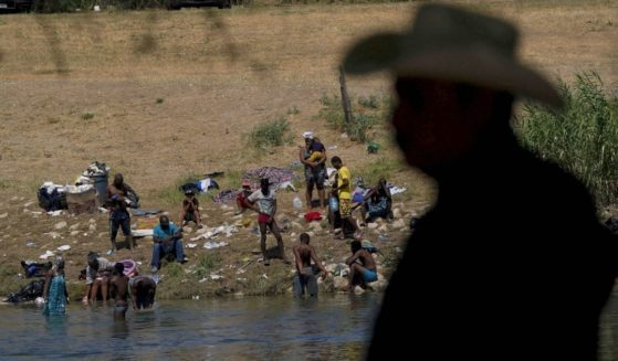 A group of migrants prepare to make their way across the Rio Grande River and into Del Rio, Texas, on Sept. 22.