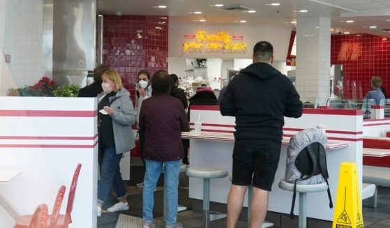 A group of customer wait inside the San Francisco In-N-Out near Fisherman's Wharf on Wednesday.