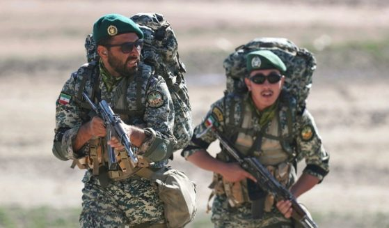 This undated picture released by the official website of the Iranian Army on Friday, Oct. 1, 2021, shows ground forces troops attending a maneuver near Iranian border with Azerbaijan.
