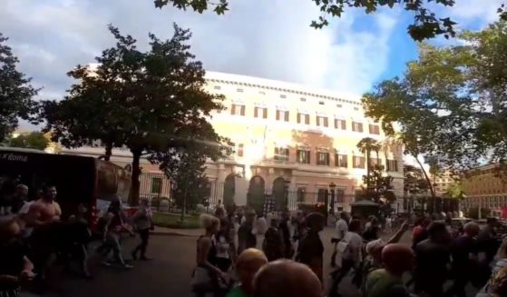 Participants in an anti-lockdown protest Sunday in Rome joined in a viral expletive-laced chant against President Joe Biden as they marched past the U.S. Embassy.