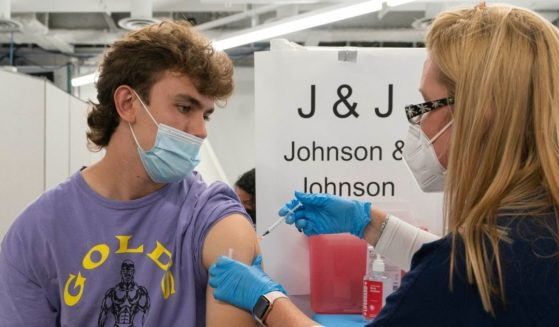 A nurse, Stephanie Wagner, administers the Johnson & Johnson vaccine to Bradley Sharp in New York on July 30.