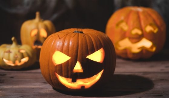 Jack-o'-lanterns are pictured on a front porch in the stock image above.