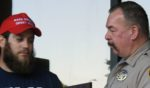 Marine veteran James Kilcer, who stopped an attempted robbery in an Arizona convenience store on Oct. 20, is presented with an award by Yuma County Sheriff Leon Wilmot.