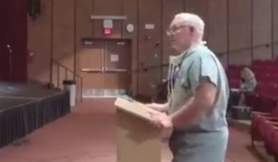 Dr. Jeffrey Horak, a Minnesota surgeon, speaks out against mask mandates in school at a school board meeting for Fergus Falls on Oct. 11.