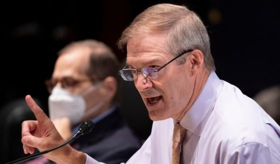 Republican Rep. Jim Jordan of Ohio speaks beside House Judiciary Chairman Jerry Nadler as Attorney General Merrick Garland appears before a Judiciary Committee hearing at the U.S. Capitol in Washington on Thursday.