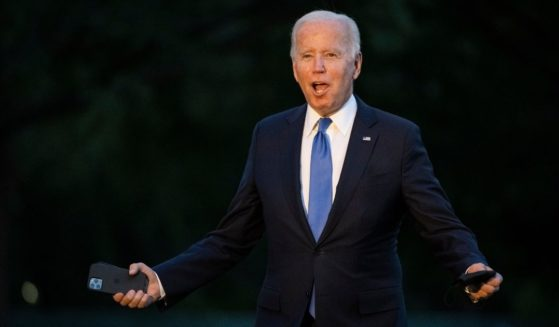 President Joe Biden, seen as he arrived at the White House Friday, has drawn heavy criticism from immigration activists for his administration's attempts to reinstate a Trump-era policy.