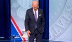 President Joe Biden stumbles during a CNN town hall in Baltimore on Thursday.