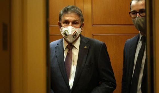 Democratic Sen. Joe Manchin of West Virginia takes an elevator at the U.S. Capitol on Oct. 6 in Washington, D.C.