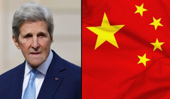 John Kerry arrives for a meeting at the Elysee Palace in Paris on Oct. 4. The Chinese flag is seen in the stock image on the right.
