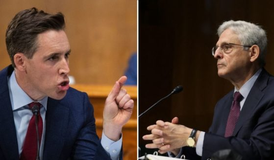 Sen. Josh Hawley, left, speaks during a Senate Judiciary Committee hearing on Capitol Hill in Washington, D.C., on Wednesday. Attorney General Merrick Garland testifies at a Senate Judiciary Committee hearing on Capitol Hill in Washington, D.C., on Wednesday.