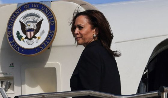 Vice President Kamala Harris looks back as she boards Air Force Two to return to Washington, D.C., from Joint Base Honolulu Pearl Harbor-Hickam, Hawaii on Aug. 26, 2021.