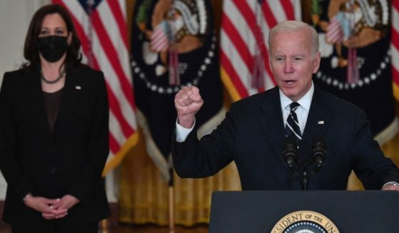 President Joe Biden speaks about his administration's social spending plans, as Vice President Kamala Harris look on, from the East Room of the White House in Washington, D.C., on Thursday.