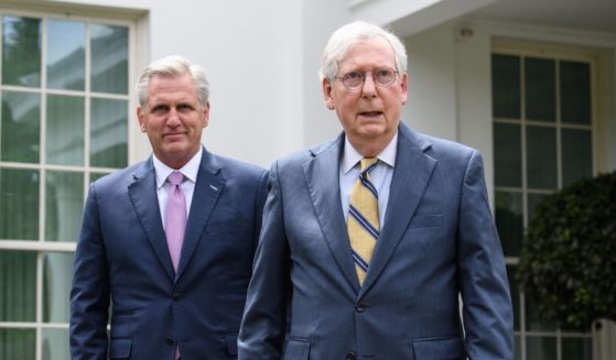 House Minority Leader Kevin McCarthy, left, and Senate Minority Leader Mitch McConnell arrive to speak to the media following their meeting with President Joe Biden and Democratic congressional leaders at the White House in Washington, D.C., on May 12, 2021.