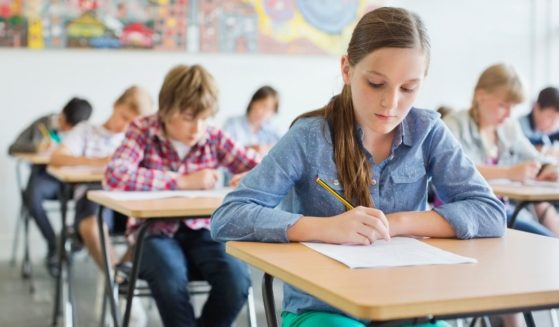 This stock image shows kids taking a test in a classroom. The 2020 National Sex Education Standards for public schools was recently released, providing guidance suggesting middle school students should be well-versed in different types of sex and sexual orientation.
