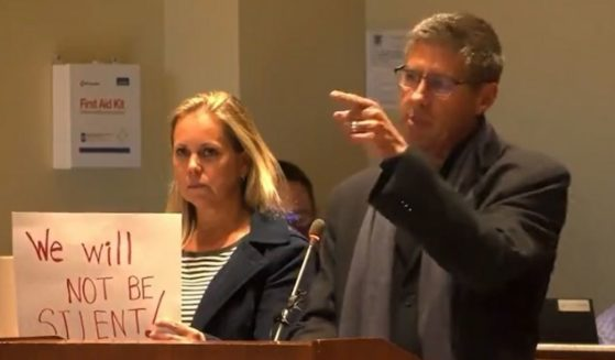 Parents address the school board in Loudoun County, Virginia, on Tuesday night.