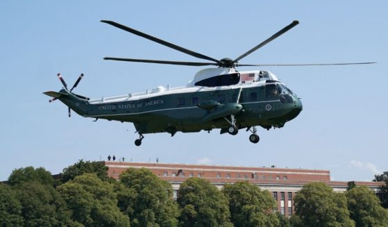 President Joe Biden makes his way to board Marine One before departing from Fort McNair in Washington, D.C., on Aug. 12, 2021.