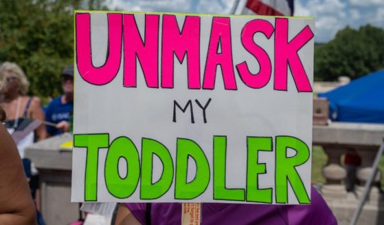 A sign protesting mask mandates is seen during the Kentucky Freedom Rally at the state's capitol building on Aug. 28 in Frankfort, Kentucky.