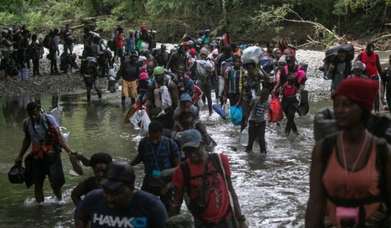 Migrants, most from Haiti, trek through the Darien Gap near Acandi, Colombia, on their journey toward the U.S. border on Tuesday.