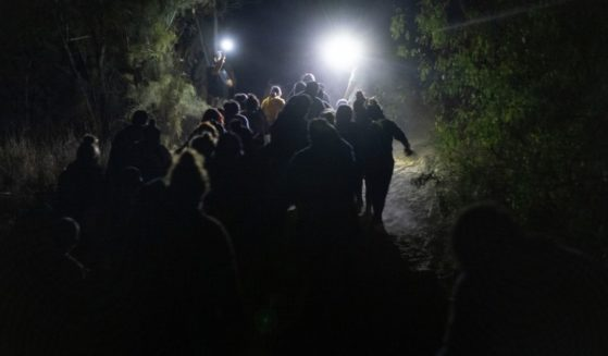 Migrants from Central American are seen near Roma, Texas, after illegally crossing the U.S.-Mexico border early on April 10.