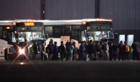 Large groups of migrant children are being transported to New York by the Biden administration late at night.