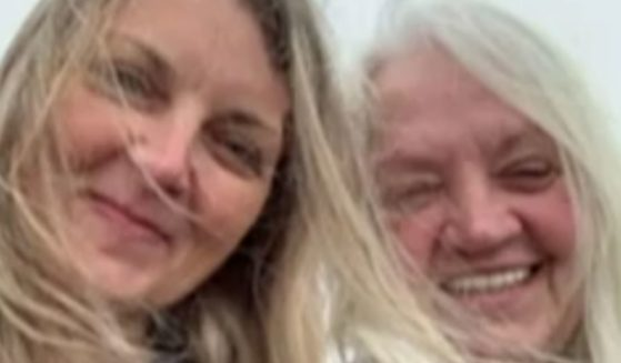 Lynn Savage, 70, right, was jailed for refusing to leave the bedside of her daughter, Amber, after the latter suffered a stroke and had brain surgery.