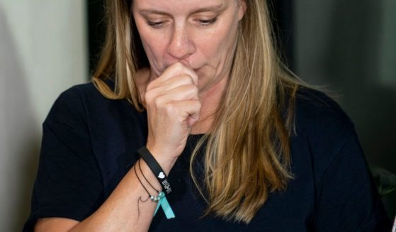 Mother of Gabby Petitio, Nichole Schmidt, holds back tears at a Sept. 28 press conference in Bohemia, New York.