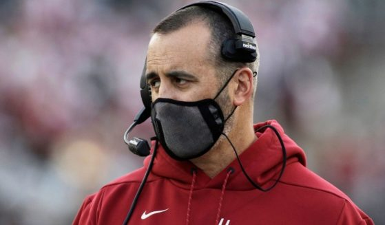 Washington State University football coach Nick Rolovich watches during the first half of an NCAA college football game against Stanford in Pullman, Washington.