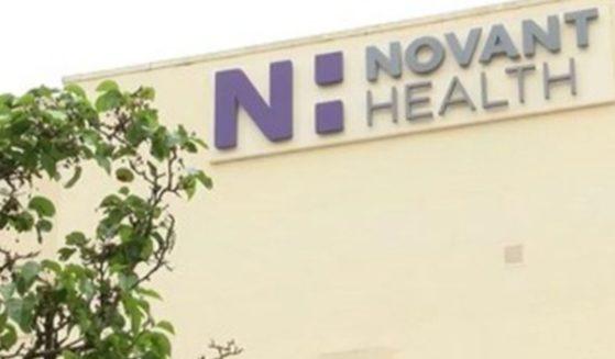 The Novant Health logo is seen on a building