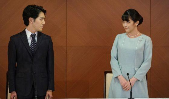Mako Komuro, elder daughter of Prince Akishino and Princess Kiko of Japan, and her husband Kei Komuro pose during a news conference on Tuesday in Tokyo.