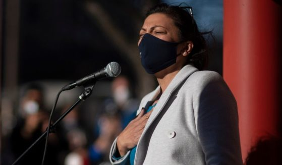 A masked Democratic Rep. Rashida Tlaib speaks during an election rally in Detroit, Michigan, on Nov. 4, 2020.