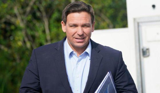 Republican governor of Florida, Ron DeSantis, prepares for a news conference in Miami on Aug. 3.